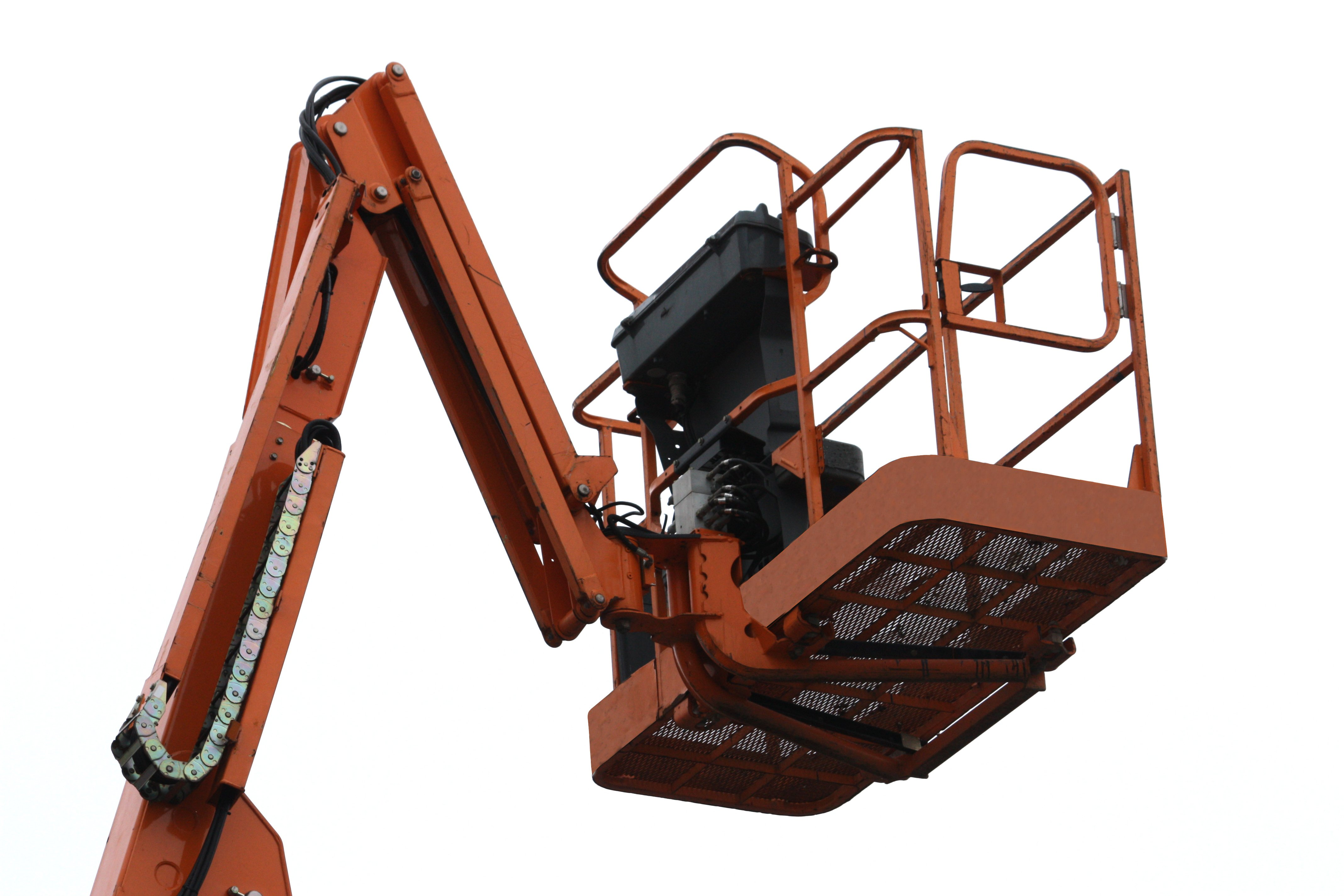 An Orange Mechanical Lift - Cherry Picker.